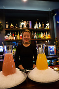 Flushing, NY - December 16, 2016. The Coop's bartender, Ava Choi, and a strawberry makgeolli cocktail (left) and a mango soju cocktail.