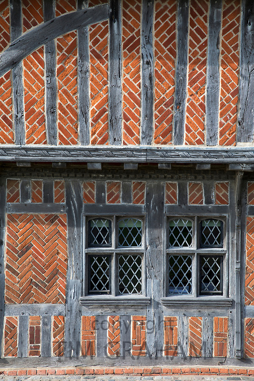 Detail of quaint brick and  timber-framed 16th Century Moot Hall  museum  with leaded light windows - The Town Hall - in Aldeburgh, Suffolk, England, UK