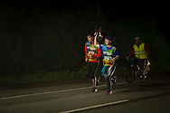 """Only 2 people run at 5:30 AM on the 20th Korrika. Murillo de las Limas  (Basque Country). April 1, 2017. The """"Korrika"""" is a relay course, with a wooden baton that passes from hand to hand without interruption, organised every two years in a bid to promote the basque language. The Korrika runs over 11 days and 10 nights, crossing many Basque villages and cities. This year was the 20th edition and run more than 2500 Kilometres. Some people consider it an honour to carry the baton with the symbol of the Basques, """"buying"""" kilometres to support Basque language teaching. (Gari Garaialde / Bostok Photo)"""