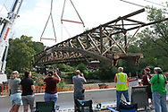 The Dreibelbis Station Bridge is moved for renovations Sept. 4, 2019, in Greenwich Township, Pennsylvania. The 172-foot-long Burr arch truss covered bridge, built in 1869, crosses Maiden Creek and is on the National Register of Historic Places.