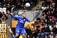 Cardiff City forward Kenneth Zohore (10) and Hull City defender Ola Aina (34) head the ball together during the EFL Sky Bet Championship match between Hull City and Cardiff City at the KCOM Stadium, Kingston upon Hull, England on 28 April 2018. Picture by Mick Atkins.
