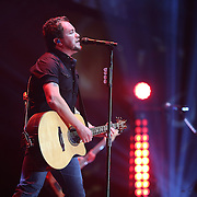 Singer Mike Eli of the Eli Young Band performs during the True Believers Tour concert at the CFE Arena on the University of Central Florida campus, on Thursday, April 24, 2014, in Orlando, Florida.  (AP Photo/Alex Menendez)