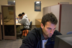 Stanford after dark. Andrew Marienberg, (05) studying at computer lair.