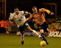 Photo: Glyn Thomas.<br />Wolverhampton Wanderers v Plymouth Argyle. Coca Cola Championship. 31/12/2005.<br />Wolves' Kenny Miller (R) holds off a challenge from Matthias Doumbe.