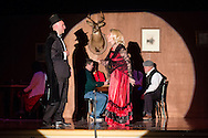 """Goshen, New York - Actors perform in a dress rehearsal for """"Yukon Saturday Night at C.J. Hooker Middle School on March 14, 2015. Proceeds from the play went to the Goshen Rotary Club's annual Family Fun Day."""