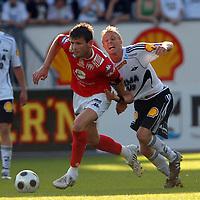Fotball Tippeligaen 04.06.08 Rosenborg - ( RBK ) - Brann,<br /> Erik Bakke BRann og Per CIljan Skjelbred RBK,<br /> Foto: Carl-Erik Eriksson, Digitalsport