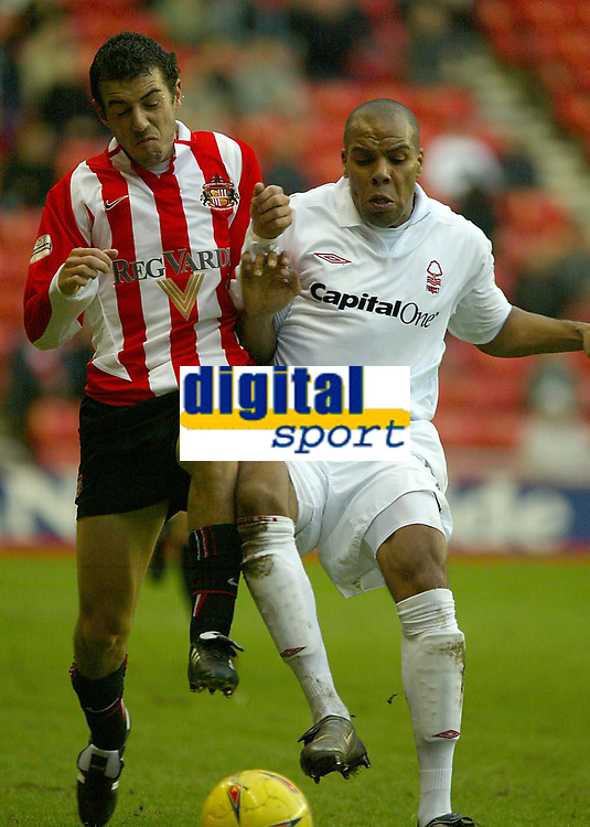 Photo. Andrew Unwin.<br /> Sunderland v Nottingham Forest, Nationwide League Division One, Stadium of Light, Sunderland 10/01/2004.<br /> Sunderland's Julio Arca (l) tussles with Forest's Marlon King (r).