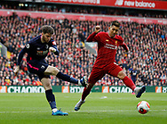 Jack Simpson of Bournemouth clears under pressure from Roberto Firmino of Liverpool during the Premier League match at Anfield, Liverpool. Picture date: 7th March 2020. Picture credit should read: Darren Staples/Sportimage