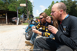 Kyle Rose enjoying some local roadside BBQ with Jason Sims during the Cross Country Chase motorcycle endurance run from Sault Sainte Marie, MI to Key West, FL. (for vintage bikes from 1930-1948). Stage-6 from Chattanooga, TN to Macon, GA USA covered 258 miles. Wednesday, September 11, 2019. Photography ©2019 Michael Lichter.