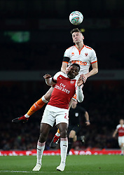 Arsenal's Danny Welbeck (front) and Blackpool's Paudie O'Connor battle for the ball