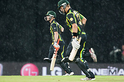 © Licensed to London News Pictures. 28/09/2012. Australian players run off as it rained breifly during the T20 Cricket World cup match between Australia Vs India at the R.Premadasa Cricket Stadium,Colombo. Photo credit : Asanka Brendon Ratnayake/LNP