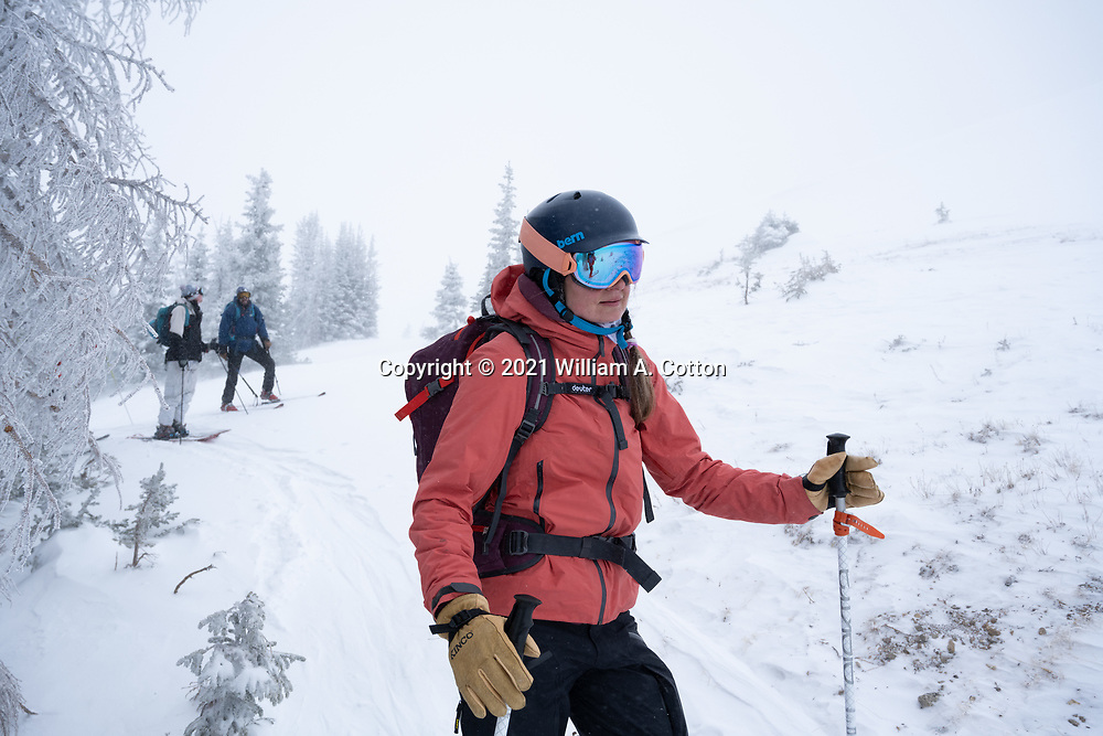 Diamond Peaks Ski Patrol member Teal Wyckoff watches as a safety lookout as another patroller crosses a potentially hazardous area near Montgomery Pass, Feb. 6, 2021.