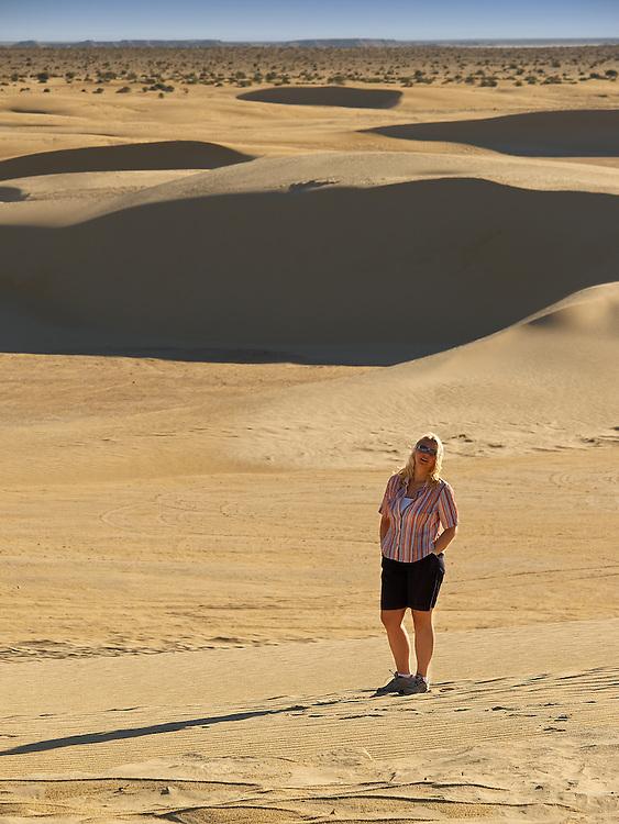 Tunisia - Woman in dunes of Sahara II