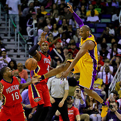 Apr 8, 2016; New Orleans, LA, USA; New Orleans Pelicans guard Toney Douglas (16) knocks the ball away from Los Angeles Lakers forward Kobe Bryant (24) as forward Dante Cunningham (44) defends during the second half of a game at the Smoothie King Center. The Pelicans defeated the Lakers 110-102. Mandatory Credit: Derick E. Hingle-USA TODAY Sports
