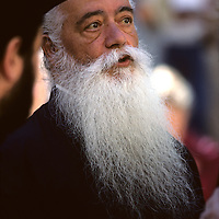 Israel, Jerusalem, Portrait of Greek Orthodox priest outside Church of Holy Sepulcher on Palm Sunday
