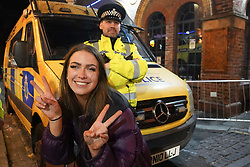 © Licensed to London News Pictures. 17/04/2021. Liverpool, UK. A reveller poses for a photograph as she enjoys the first weekend in Liverpool city centre after lockdown restrictions were eased Photo credit:  Ioannis Alexopoulos/LNP