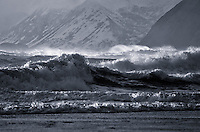 Two surfers head out in winter waves in Kodiak, Alaska -- during the winter!