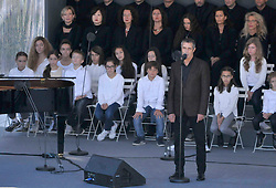 French Singer Julien Clerc performing during the National Ceremony for the 86 victims of Nice terror attack on last 14th July 2016 at the Colline du Château in Nice, southern France, on october 15, 2016. Ministers and politicians in front of about 2000 people including the victims families and rescue forces participated ceremony. Photo by Pierre Rousseau/CIT'images/ABACAPRESS.COM