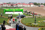 Gerkli is paraded as the winner of the prestigious 'Most Beautiful Horse in Turkmenistan 2010', followed by owner Ahmet Berdiev leaning out of a brand new Jaguar car (his prize), in Ashgabat, Turkmenistan.