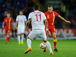 Craig Bellamy of Wales (Cardiff City) is challenged by Aleksandar Kolarov of Serbia (Manchester City) during the second half of the match - Photo mandatory by-line: Rogan Thomson/JMP - Tel: Mobile: 07966 386802 10/09/2013 - SPORT - FOOTBALL - Cardiff City Stadium - Cardiff -  Wales V Serbia- World Cup Qualifier.