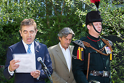 """© Licensed to London News Pictures. 19/05/2014. London, England. Pictured: Actors Rowan Atkinson and Nigel Havers reading war poems.  Show Garden """"No Man's Land: ABF The Soldiers' Charity Garden to mark the centenary of World War One.  Press Day at the RHS Chelsea Flower Show. On Tuesday, 20 May 2014 the flower show will open its doors to the public.  Photo credit: Bettina Strenske/LNP"""