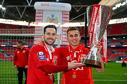 Greg Cunningham and Joe Bryan hold the Football League Trophy after Bristol City win the match 2-0 - Photo mandatory by-line: Rogan Thomson/JMP - 07966 386802 - 22/03/2015 - SPORT - FOOTBALL - London, England - Wembley Stadium - Bristol City v Walsall - Johnstone's Paint Trophy Final.