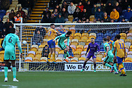 Mansfield Town defender Ryan Sweeney (17) heads the ball clear during the EFL Sky Bet League 2 match between Mansfield Town and Carlisle United at the One Call Stadium, Mansfield, England on 1 February 2020.