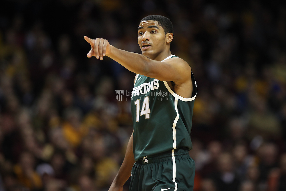 Dec 31, 2012; Minneapolis, MN, USA; Michigan State Spartans guard Gary Harris (14) calls a play during the first half against the Minnesota Golden Gophers at Williams Arena. Minnesota defeated Michigan State 76-63. Mandatory Credit: Brace Hemmelgarn