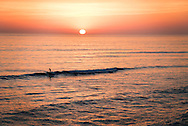 Lone surfer, riding last wave at last light during sunset at Terramar Beach in Carlsbad, CA.<br /> <br /> THIS IMAGE ALSO AVAILABLE AS SIGNED, LIMITED EDITION PRINT. SERIES LIMITED TO 10. EMAIL RR@ROBERTRANDALL.COM FOR PRICING