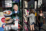 Tourist postcards of Prince Charles for sale near Piccadilly Circus, London, UK. Also other British icons such as the full English breakfast and the cup of tea.