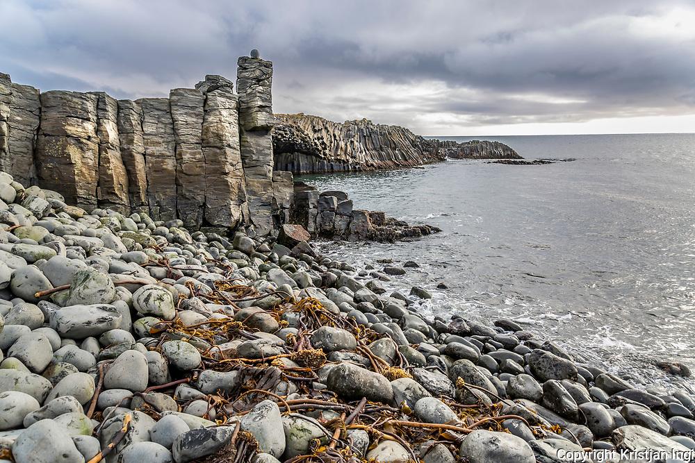 Columnar basalt, or trap rock, formed from slow-cooling magma, lines the northern <br /> shore at Kálfshamarsvík, near the northern end of the peninsula Skagaströnd.