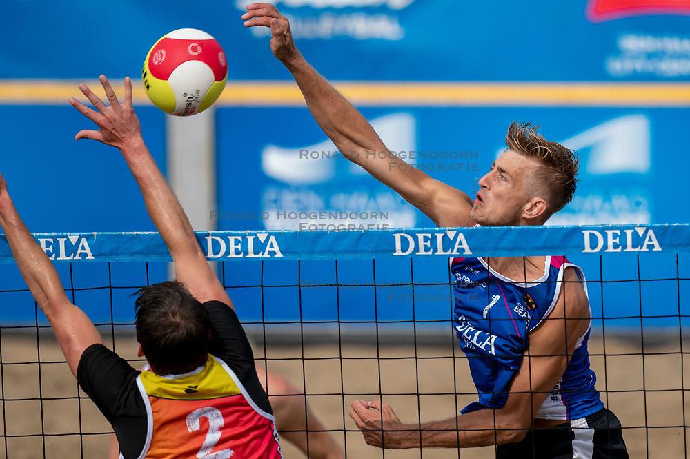 Steven van de Velde in action. The DELA NK Beach volleyball for men and women will be played in The Hague Beach Stadium on the beach of Scheveningen on 22 July 2020 in Zaandam.