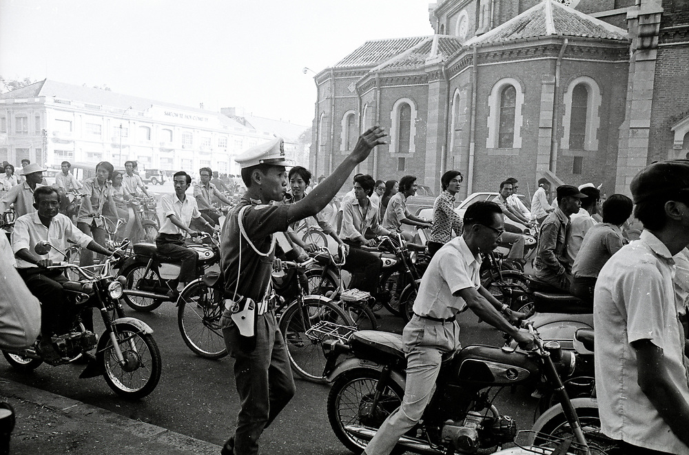 Panic on the streets of Saigon as the North Vietnamese army  gets closer to the capital city in April 1975. Photograph by Terry Fincher