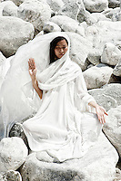 """Archetypal asian woman meditating in the stones.<br /> ::::::::::::::::::::::::::::::::::::::::::::::::::::::::::::::::::::::<br /> """"I work a lot with metta, the Buddhist practice of cultivating compassion. I visualize people who are central to my life. As each person comes to mind I offer this blessing: May you be free from fear. May you be free from compulsion. May you be blessed with love. May you be blessed with peace. Reciting this reminds me that the hurtful things we do and say are often an expression of our fears and compulsions and are not freely chosen acts of harm. Knowing this allows me to have compassion for others and myself as well.""""<br /> -Rabbi Rami"""