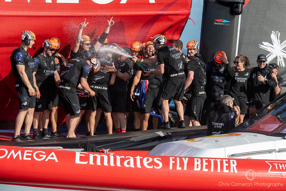 Emirates Team New Zealand main sail trimmer Glen Ashby sprays champagne on board after winning the America's Cup against Luna Rossa Prada Pirelli Team 7 - 3.  Wednesday the 17th of March 2021. Copyright photo: Chris Cameron