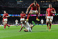 Jonny May of England scores his teams 1st try as Wales players inc Liam Williams (jumping) look on dejected. Rugby World Cup 2015 pool A match, England v Wales at Twickenham Stadium in London, England  on Saturday 26th September 2015.<br /> pic by  Andrew Orchard, Andrew Orchard sports photography.