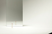 mirror with matchstick