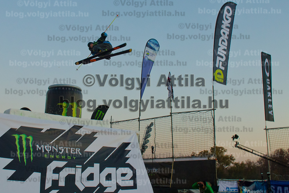 Fridtjof Fredricsson from Norway performs his trick during the freestyle skiing competition held on the 35 meters high artificial ski jumping ramp on the Monster Energy Fridge Festival in central Budapest, Hungary on November 12, 2011. ATTILA VOLGYI