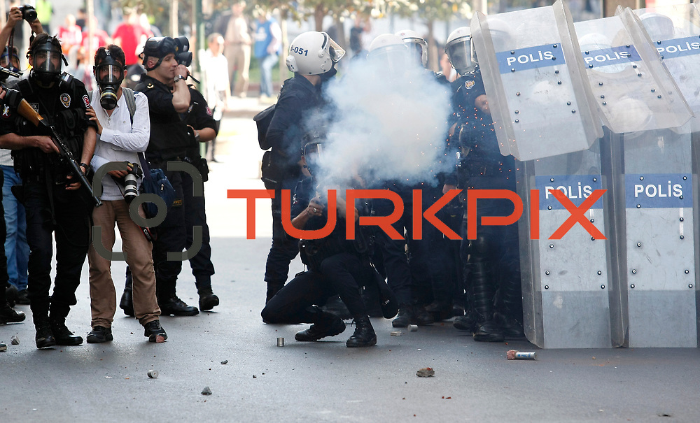 A Turkish riot police fires tear gas against May Day protesters as they disperse crowds that tried to break through barricades to reach the city's main square in central Istanbul May 1, 2013. Turkish riot police clashed with thousands of May Day protesters in Istanbul on Wednesday, firing water cannon and tear gas at crowds that tried to break through barricades to reach the city's main square, witnesses said. The incidents followed the pattern of recent years, when May Day demonstrations in Turkey's largest city have often been marked by clashes between police and protesters. May 1 demonstrations in Istanbul organized demonstrators clashed with police in protest against the government. Events, many demonstrators were injured, a large number of people affected by the tear gas used by police. Photo by AYKUT AKICI/TURKPIX