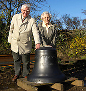 UK - Friday, Nov 07 2008:  Anne and Brian Horrell stand behind the 6th bell at Nicholson Engineering, Bridport, Dorset. The bell was recently cast and is destined for St Mary's Church on the Isles of Scilly. The bells were cast at Whitechapel Bell Foundry, London. Nicholson are building the frame to hold the bells. (Photo by Peter Horrell / http://www.peterhorrell.com)