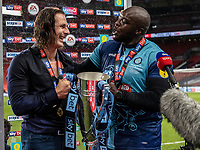 Wycombe Wanderers' Gareth Ainsworth and Adebayo Akinfenwa (right) are interviewed by the media <br /> <br /> Photographer Andrew Kearns/CameraSport<br /> <br /> Sky Bet League One Play Off Final - Oxford United v Wycombe Wanderers - Monday July 13th 2020 - Wembley Stadium - London<br /> <br /> World Copyright © 2020 CameraSport. All rights reserved. 43 Linden Ave. Countesthorpe. Leicester. England. LE8 5PG - Tel: +44 (0) 116 277 4147 - admin@camerasport.com - www.camerasport.com