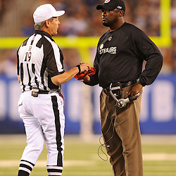 21 Aug, 2010: Referee Scott Green (left) returns Pittsburgh Steelers head coach Mike Tomlin's challenge flag after Tomlin elected to challenge the call on a Giants touchdown during second half NFL preseason action between the New York Giants and Pittsburgh Steelers at New Meadowlands Stadium in East Rutherford, New Jersey. The Steelers beat the Giants 24-17.