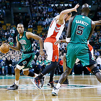 13 March 2013: Boston Celtics point guard Avery Bradley (0) drives past Toronto Raptors point guard Kyle Lowry (3) on a screen set by Boston Celtics center Kevin Garnett (5) during the Boston Celtics 112-88 victory over the Toronto Raptors at the TD Garden, Boston, Massachusetts, USA.