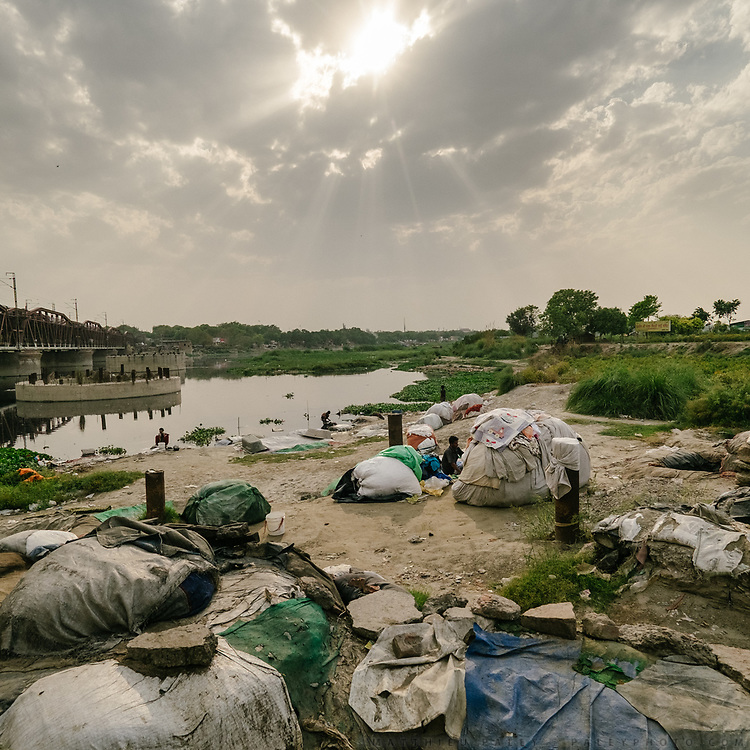 Laundry men cleaning using wtaer from the Yamuna.