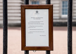 The announcement of the death of the Duke of Edinburgh, who has died at the age of 99, hangs on the gates of Buckingham Palace, London. Picture date: Friday April 9, 2021.