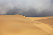 Storm clouds and fog rolling in on the large sand dunes of the Skeleton Coast,Namibia
