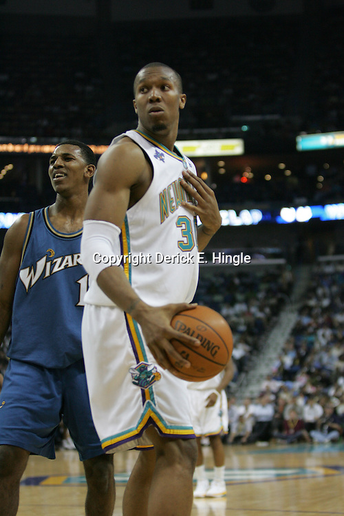 Hornets forward David West #30 protest a called foul against himself on February 25, 2008 at the New Orleans Arena in New Orleans, Louisiana. The New Orleans Hornets lost 95-92 to the Washington Wizards.