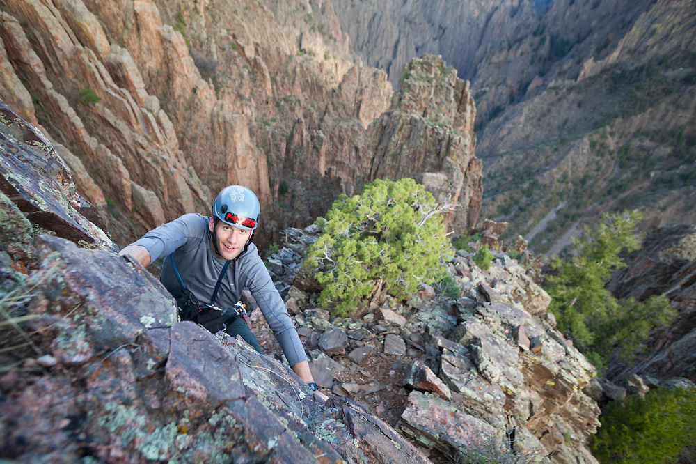 Obadiah Reid scrambles up the Island Peaks in Black Canyon of the Gunnison National Park, Colorado.