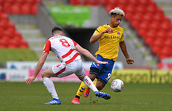 Charlton Athletic's Lyle Taylor (right) battles with Doncaster Rovers' Ben Whiteman