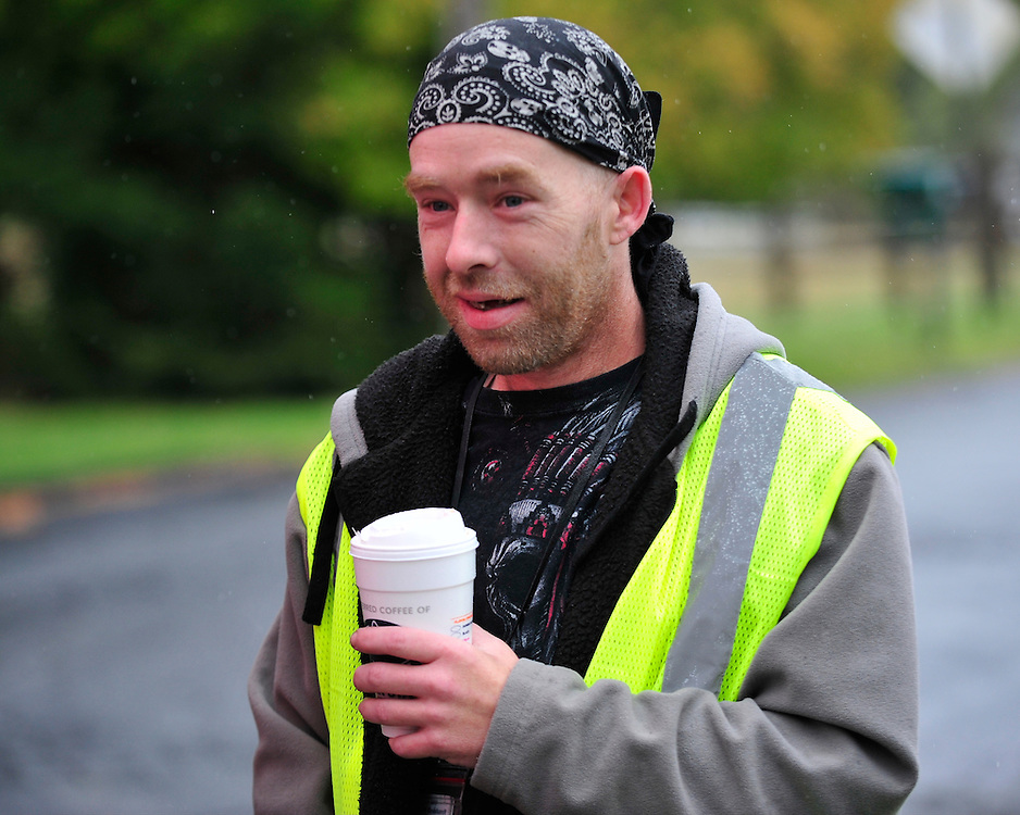 James Tully who police have stopped multiple times because they believe he looks like fugitive Eric Matthew Frein sips coffee on his break outside his place of employment. Oct. 22, 2014, near Canadensis, Pa. (Chris Post | lehighvalleylive.com)